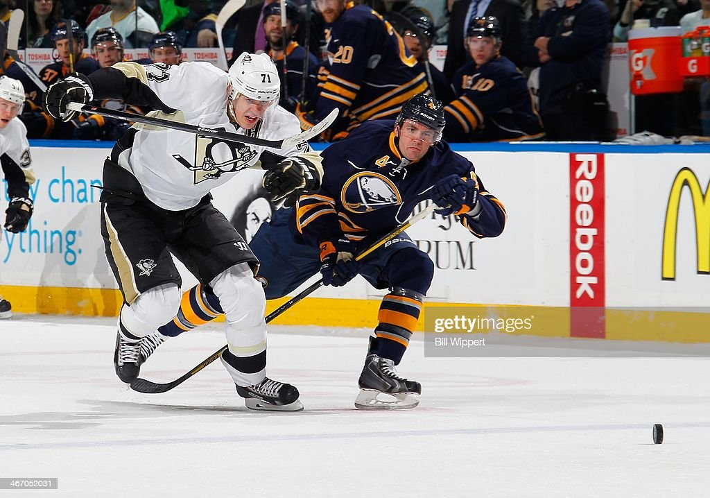 Evgeni Malikin #71 of the Pittsburgh Penguins avoids Jamie McBain #4 of the Buffalo Sabres on his way to scoring a second period goal on February 5, 2014 at the First Niagara Center in Buffalo, New York.