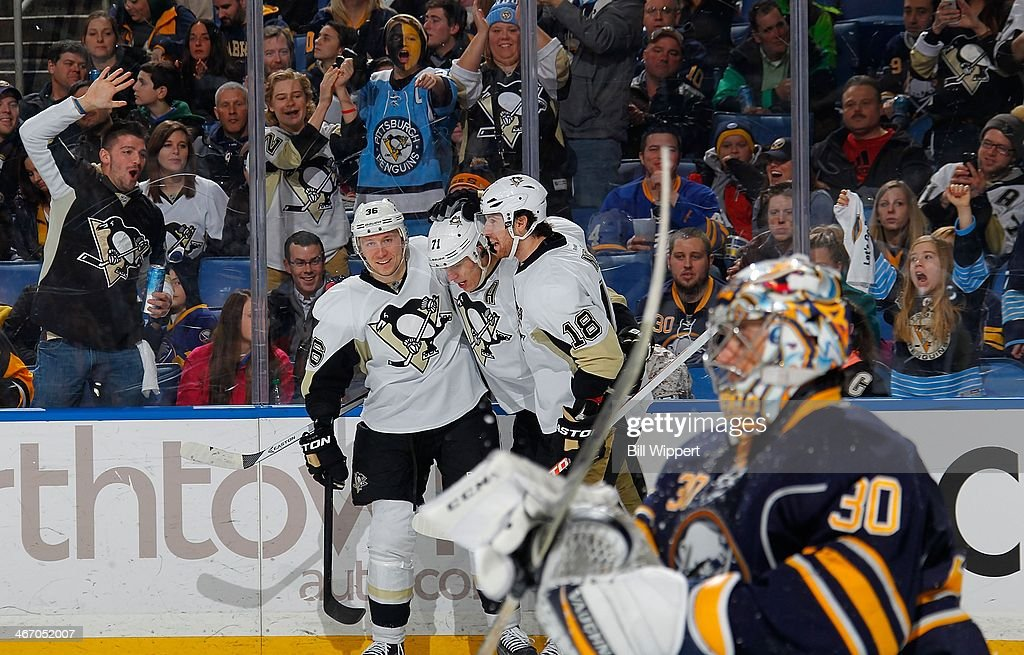 Evgeni Malikin #71 of the Pittsburgh Penguins celebrates scoring a second period goal against Ryan Miller #30 of the Buffalo Sabres with teammates Jussi Jokinen #36 and James Neal #18 on February 5, 2014 at the First Niagara Center in Buffalo, New York.