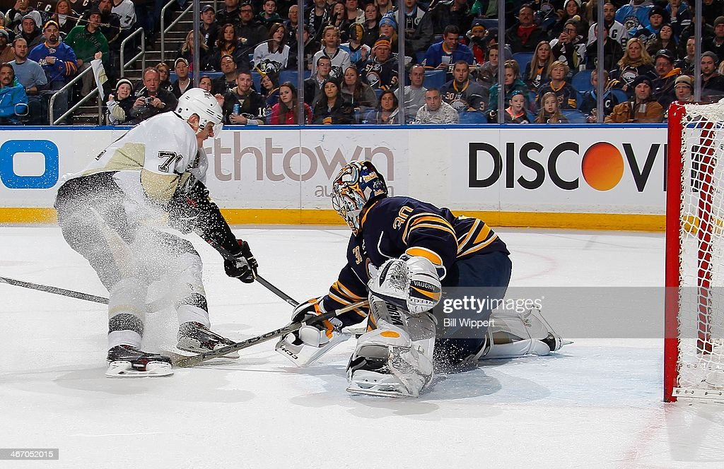 Evgeni Malikin #71 of the Pittsburgh Penguins scores a second period goal against Ryan Miller #30 of the Buffalo Sabres on February 5, 2014 at the First Niagara Center in Buffalo, New York.