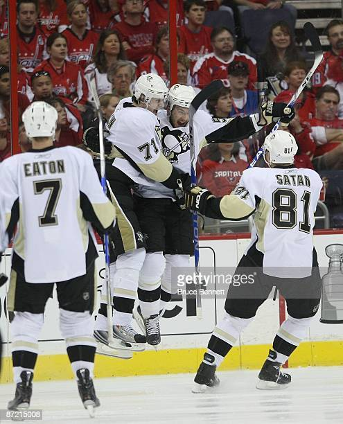 Evgeni Malkin and Kris Letang of the Pittsburgh Penguins celebrate Letangs goal at 1013 of the second period against the Washington Capitals during...