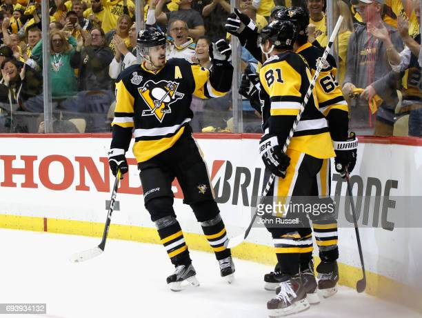 Evgeni Malkin and Phil Kessel of the Pittsburgh Penguins celebrate assisting on teammate Ron Hainsey goal during the second period of Game Five of...