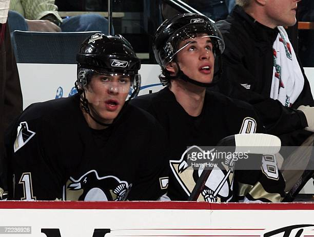 Evgeni Malkin and Sidney Crosby of the Pittsburgh Penguins on the bench against the Columbus Blue Jackets during the first period at Mellon Arena on...