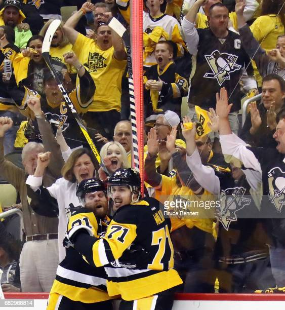 Evgeni Malkin celebrates his third period goal against Craig Anderson of the Ottawa Senators and is joined by Phil Kessel in Game One of the Eastern...