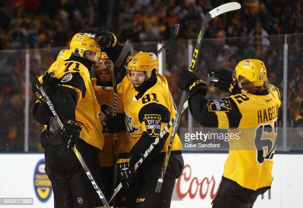 Evgeni Malkin Ian Cole Phil Kessel and Carl Hagelin of the Pittsburgh Penguins celebrate Chad Ruhwedel's goal during the third period of the 2017...