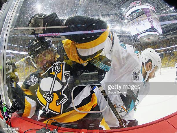 Evgeni Malkin of the Pittsburgh Penguins and Dainius Zubrus of the San Jose Sharks battle along the boards during the third period in Game One of the...