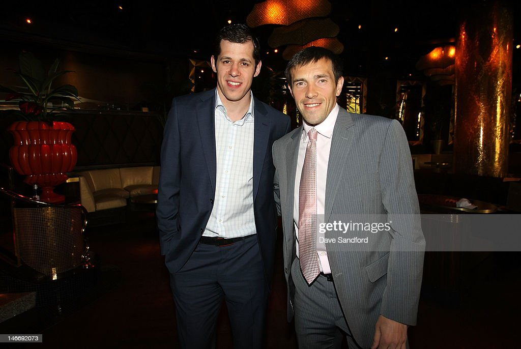 Evgeni Malkin of the Pittsburgh Penguins and Pavel Datsyuk of the Detroit Red Wings arrive before the 2012 NHL Awards at the Encore Theater at the Wynn Las Vegas on June 20, 2012 in Las Vegas, Nevada.