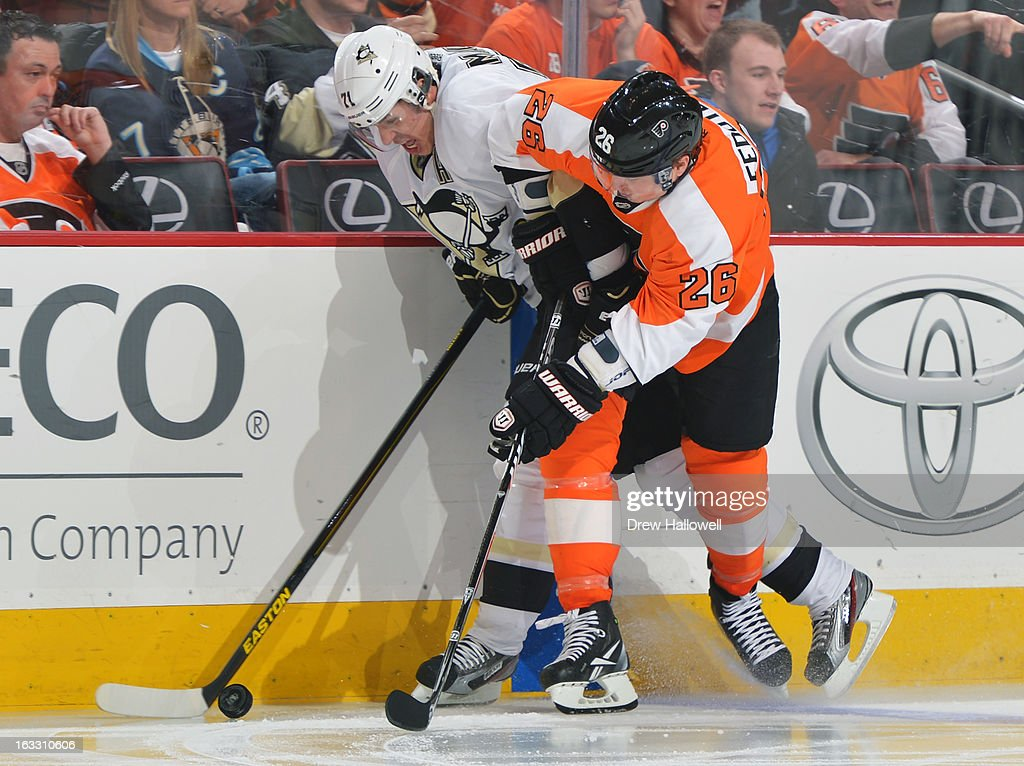 Evgeni Malkin #71 of the Pittsburgh Penguins and Ruslan Fedotenko #26 of the Philadelphia Flyers battle along the boards at the Wells Fargo Center on March 7, 2013 in Philadelphia, Pennsylvania. The Penguins won 5-4.