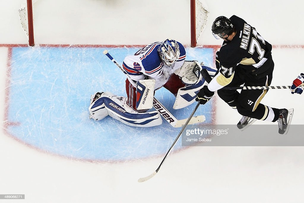 Evgeni Malkin #71 of the Pittsburgh Penguins attempts to screen goaltender Henrik Lundqvist #30 of the New York Rangers as Lundqvist makes a save in the third period in Game Five of the Second Round of the 2014 NHL Stanley Cup Playoffs on May 9, 2014 at CONSOL Energy Center in Pittsburgh, Pennsylvania. New York defeated Pittsburgh 5-1.