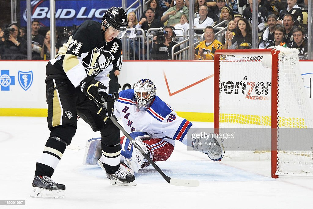 Evgeni Malkin #71 of the Pittsburgh Penguins catches the puck on the rebound off his own shot before turning around and scoring on a second shot on goaltender Henrik Lundqvist #30 of the New York Rangers in the second period in Game Five of the Second Round of the 2014 NHL Stanley Cup Playoffs on May 9, 2014 at CONSOL Energy Center in Pittsburgh, Pennsylvania.