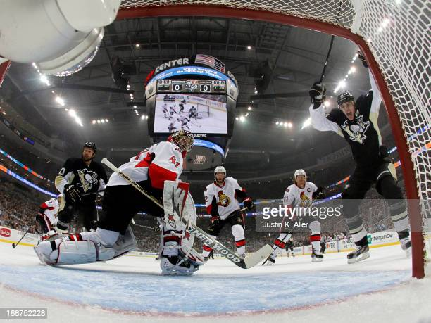 Evgeni Malkin of the Pittsburgh Penguins celebrates a goal by Paul Martin against Craig Anderson of the Ottawa Senators in Game One of the Eastern...