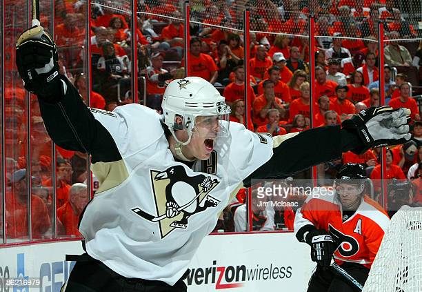 Evgeni Malkin of the Pittsburgh Penguins celebrates after assisting on his teams fourth goal against the Philadelphia Flyers during Game Six of the...