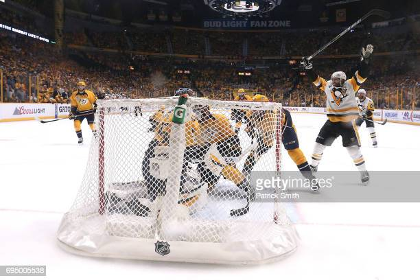 Evgeni Malkin of the Pittsburgh Penguins celebrates after Patric Hornqvist scored a goal against Pekka Rinne of the Nashville Predators during the...