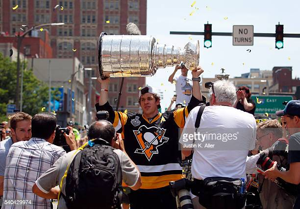 Evgeni Malkin of the Pittsburgh Penguins celebrates during the Victory Parade and Rally on June 15 2016 in Pittsburgh Pennsylvania