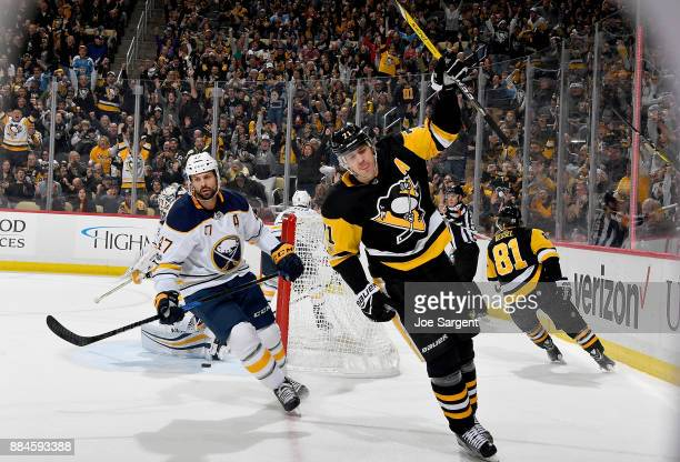 Evgeni Malkin of the Pittsburgh Penguins celebrates his first period goal against the Buffalo Sabres at PPG Paints Arena on December 2 2017 in...