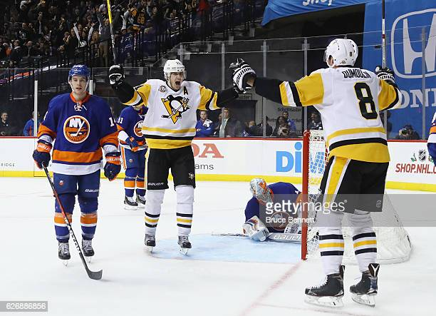 Evgeni Malkin of the Pittsburgh Penguins celebrates his game tying goal at 1308 of the third period against the New York Islanders at the Barclays...