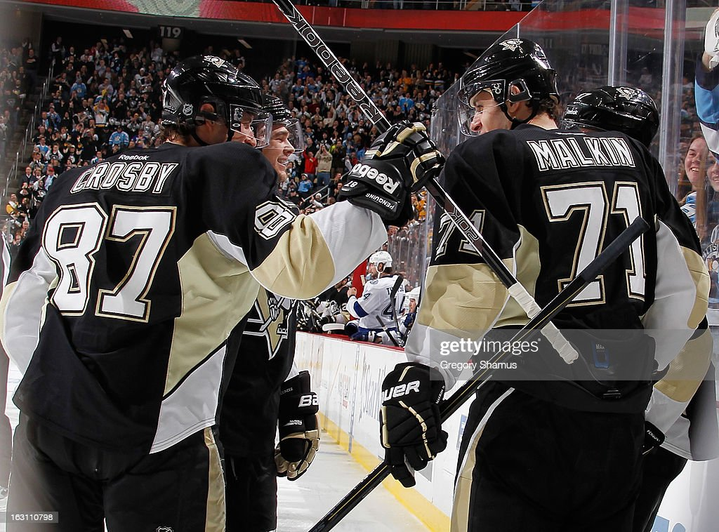 Evgeni Malkin #71 of the Pittsburgh Penguins celebrates his goal with Sidney Crosby #87 and Chris Kunitz #14 during the third period against the Tampa Bay Lightning on March 4, 2013 at Consol Energy Center in Pittsburgh, Pennsylvania.