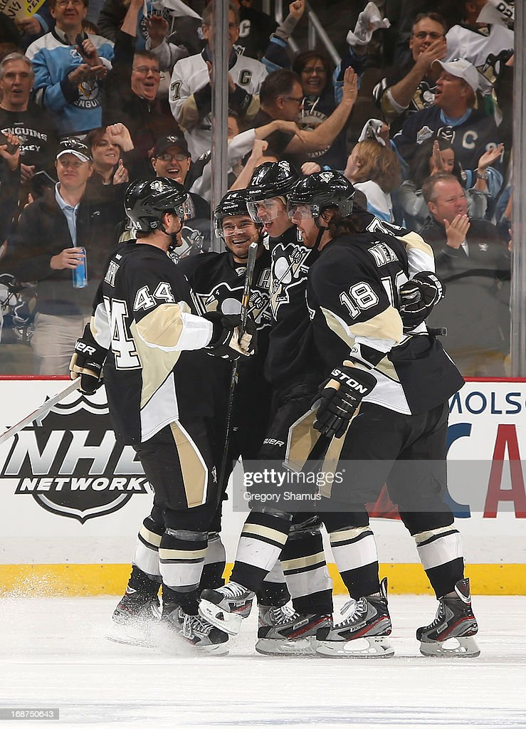 Evgeni Malkin #71 of the Pittsburgh Penguins celebrates his goal with teammates during the first period against the Ottawa Senators in Game One of the Eastern Conference Semifinals during the 2013 NHL Stanley Cup Playoffs at Consol Energy Center on May 14, 2013 in Pittsburgh, Pennsylvania.