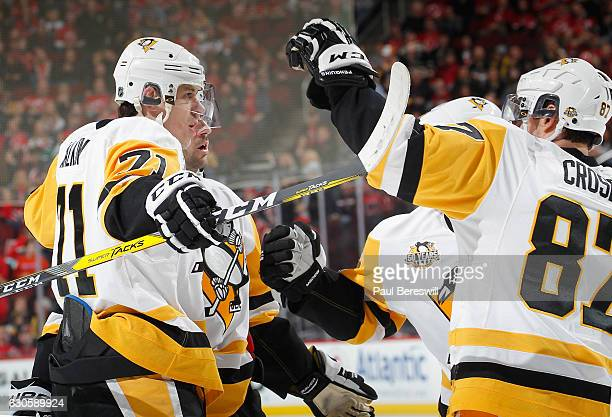 Evgeni Malkin of the Pittsburgh Penguins celebrates his goal with Sidney Crosby of the Pittsburgh Penguins in the first period of an NHL hockey game...
