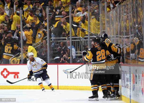 Evgeni Malkin of the Pittsburgh Penguins celebrates his goal with teammates during the third period of Game Two of the 2017 NHL Stanley Cup Final...