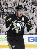 Evgeni Malkin of the Pittsburgh Penguins celebrates his second goal of the game against the Ottawa Senators in Game One of the Eastern Conference...