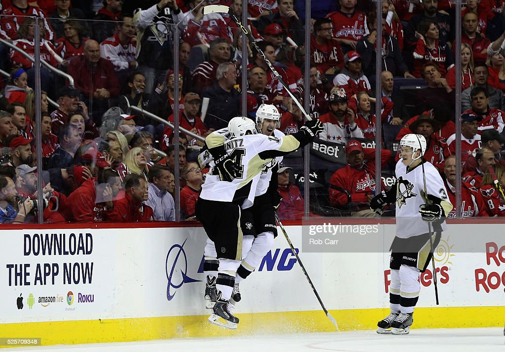 <a gi-track='captionPersonalityLinkClicked' href=/galleries/search?phrase=Evgeni+Malkin&family=editorial&specificpeople=221676 ng-click='$event.stopPropagation()'>Evgeni Malkin</a> #71 of the Pittsburgh Penguins (C) celebrates his second period goal with teammates <a gi-track='captionPersonalityLinkClicked' href=/galleries/search?phrase=Chris+Kunitz&family=editorial&specificpeople=604159 ng-click='$event.stopPropagation()'>Chris Kunitz</a> #14 and Olli Maatta #3 against the Washington Capitals in Game One of the Eastern Conference Second Round during the 2016 NHL Stanley Cup Playoffs at Verizon Center on April 28, 2016 in Washington, DC.
