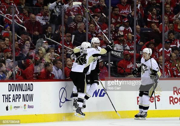 Evgeni Malkin of the Pittsburgh Penguins celebrates his second period goal with teammates Chris Kunitz and Olli Maatta against the Washington...