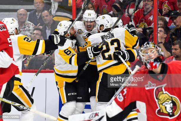 Evgeni Malkin of the Pittsburgh Penguins celebrates his second period goal with teammates against the Ottawa Senators in Game Six of the Eastern...
