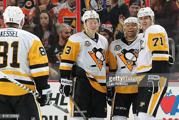 Evgeni Malkin of the Pittsburgh Penguins celebrates his third period goal against the Philadelphia Flyers with teammates Phil Kessel Olli Maatta and...