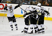 Evgeni Malkin of the Pittsburgh Penguins celebrates with his teammates after scoring against the San Jose Sharks in the second period of Game Four of...