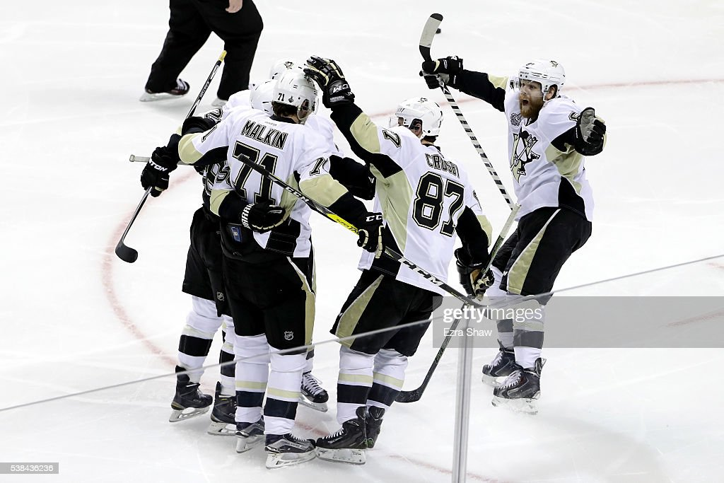 Evgeni Malkin #71 of the Pittsburgh Penguins celebrates with his teammates after scoring against the San Jose Sharks in the second period of Game Four of the 2016 NHL Stanley Cup Final at SAP Center on June 6, 2016 in San Jose, California.
