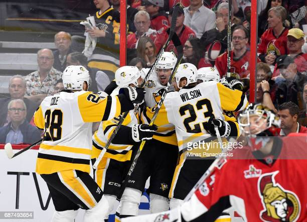 Evgeni Malkin of the Pittsburgh Penguins celebrates with his teammates after scoring a goal on Craig Anderson of the Ottawa Senators during the...