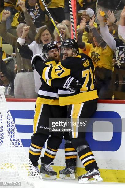 Evgeni Malkin of the Pittsburgh Penguins celebrates with his teammate Phil Kessel after scoring a goal against Craig Anderson of the Ottawa Senators...