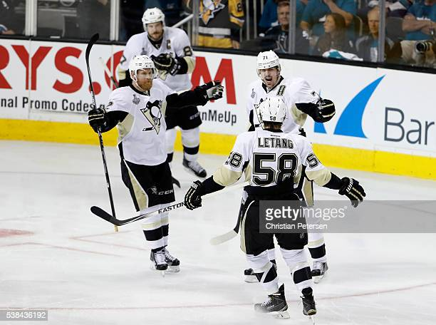 Evgeni Malkin of the Pittsburgh Penguins celebrates with Patric Hornqvist and Kris Letang after scoring against the San Jose Sharks in the second...