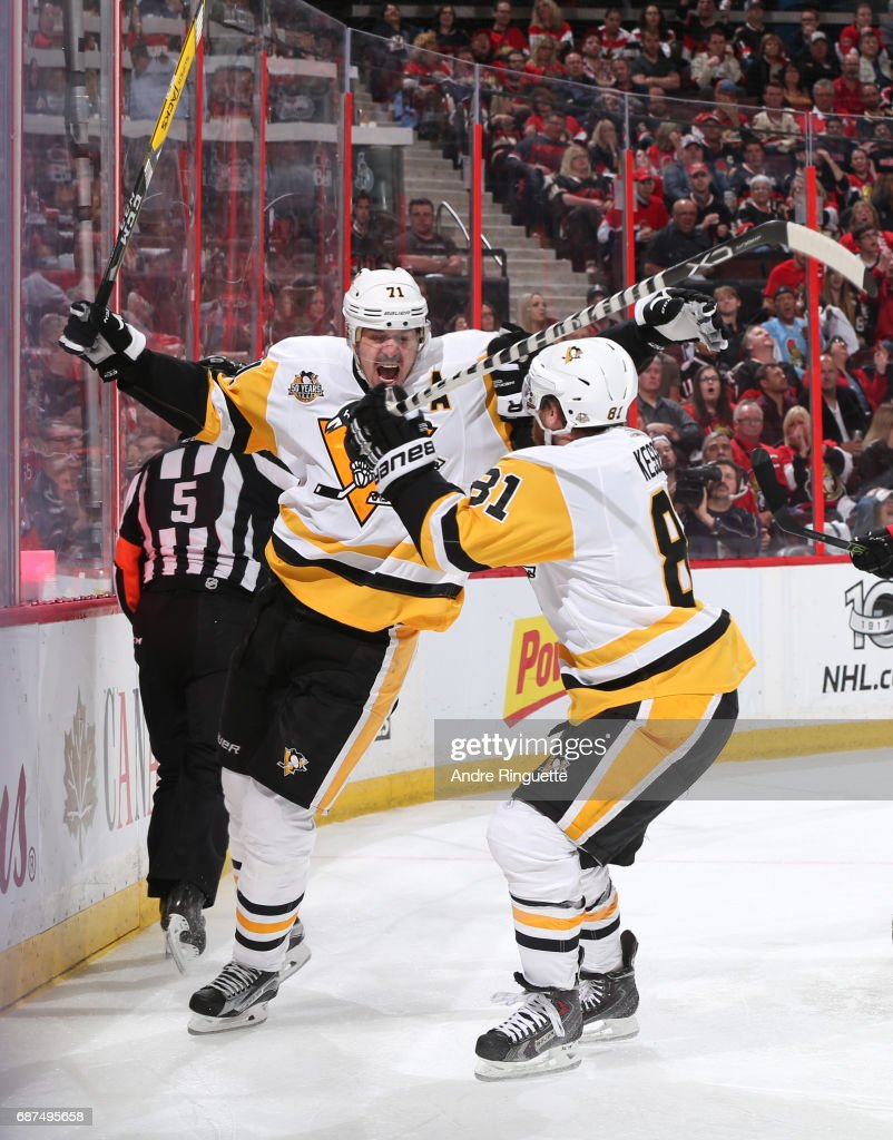Evgeni Malkin #71 of the Pittsburgh Penguins celebrates with teammate Phil Kessel #81 after scoring a second period goal on the Ottawa Senators in Game Six of the Eastern Conference Final during the 2017 NHL Stanley Cup Playoffs at Canadian Tire Centre on May 23, 2017 in Ottawa, Ontario, Canada.