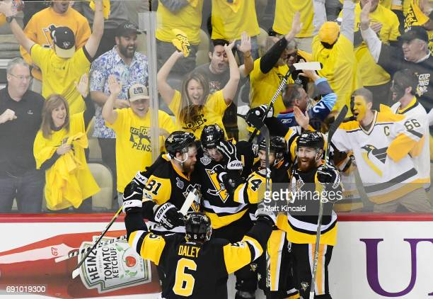 Evgeni Malkin of the Pittsburgh Penguins celebrates with teammates after scoring a goal during the third period in Game Two of the 2017 NHL Stanley...
