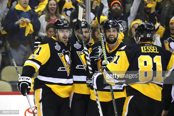 Evgeni Malkin of the Pittsburgh Penguins celebrates with teammates after scoring his team's third goal in the first period against the Nashville...