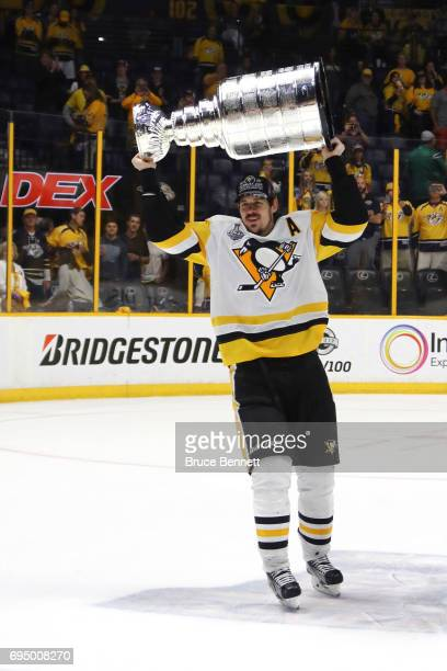 Evgeni Malkin of the Pittsburgh Penguins celebrates with the Stanley Cup Trophy after they defeated the Nashville Predators 20 in Game Six of the...