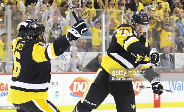 Evgeni Malkin of the Pittsburgh Penguins celebrates with Trevor Daley after scoring a goal during the first period in Game One of the 2017 NHL...