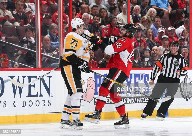 Evgeni Malkin of the Pittsburgh Penguins clashes with Mike Hoffman of the Ottawa Senators in Game Six of the Eastern Conference Final during the 2017...