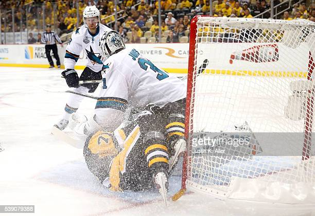 Evgeni Malkin of the Pittsburgh Penguins collides into Martin Jones of the San Jose Sharks during the second period in Game Five of the 2016 NHL...