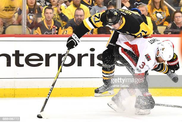 Evgeni Malkin of the Pittsburgh Penguins collides with Marc Methot of the Ottawa Senators during the second period in Game Seven of the Eastern...