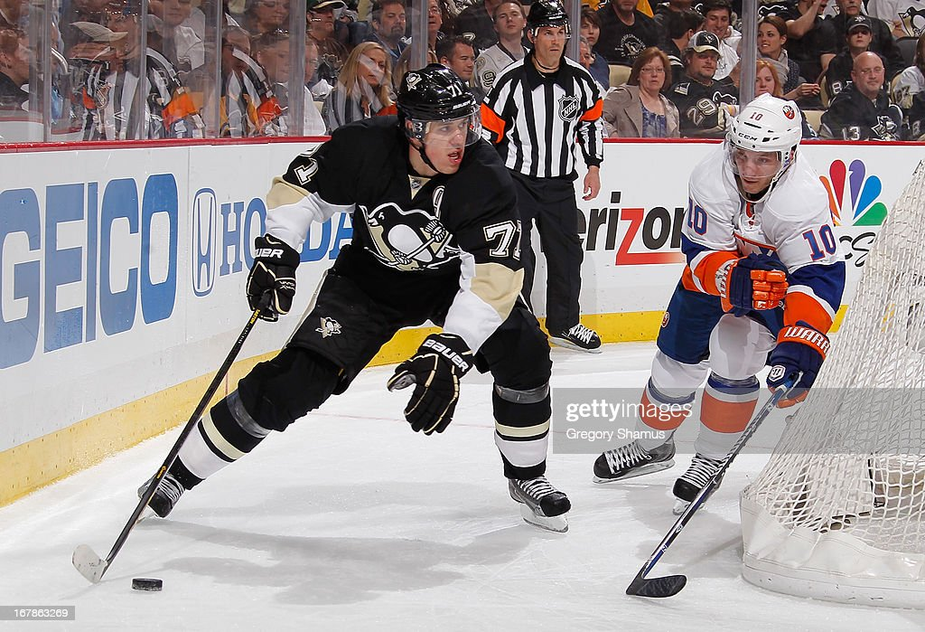 Evgeni Malkin #71 of the Pittsburgh Penguins controls the puck in front of Keith Aucoin #10 of the New York Islanders in Game One of the Eastern Conference Quarterfinals during the 2013 NHL Stanley Cup Playoffs at Consol Energy Center on May 1, 2013 in Pittsburgh, Pennsylvania.