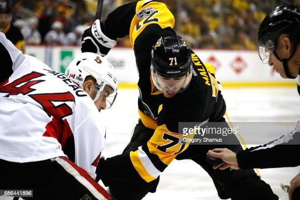 Evgeni Malkin of the Pittsburgh Penguins faces off against JeanGabriel Pageau of the Ottawa Senators in Game Five of the Eastern Conference Final...