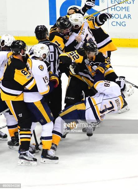 Evgeni Malkin of the Pittsburgh Penguins fights Roman Josi of the Nashville Predators as Carl Hagelin of the Pittsburgh Penguins fights Viktor...