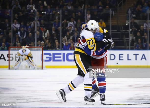 Evgeni Malkin of the Pittsburgh Penguins fights with Kevin Shattenkirk of the New York Rangers at Madison Square Garden on October 17 2017 in New...