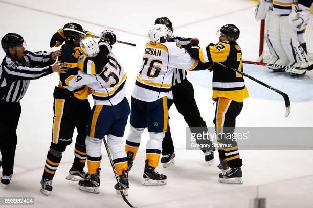 Evgeni Malkin of the Pittsburgh Penguins fights with Roman Josi of the Nashville Predators as PK Subban of the Nashville Predators fights with Patric...