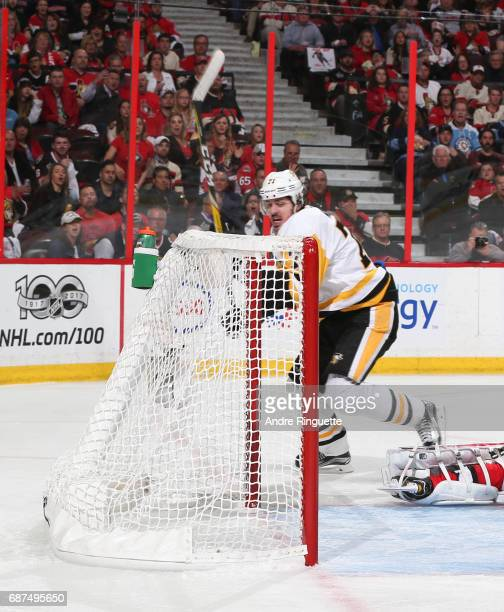 Evgeni Malkin of the Pittsburgh Penguins gets the puck past Craig Anderson of the Ottawa Senators to score a second period goal in Game Six of the...