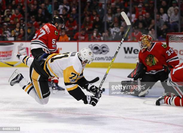 Evgeni Malkin of the Pittsburgh Penguins goes airborne as Scott Darling of the Chicago Blackhawks makes the save at the United Center on March 1 2017...
