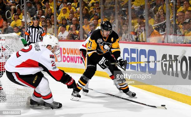 Evgeni Malkin of the Pittsburgh Penguins handled the puck against Dion Phaneuf of the Ottawa Senators in Game Seven of the Eastern Conference Final...