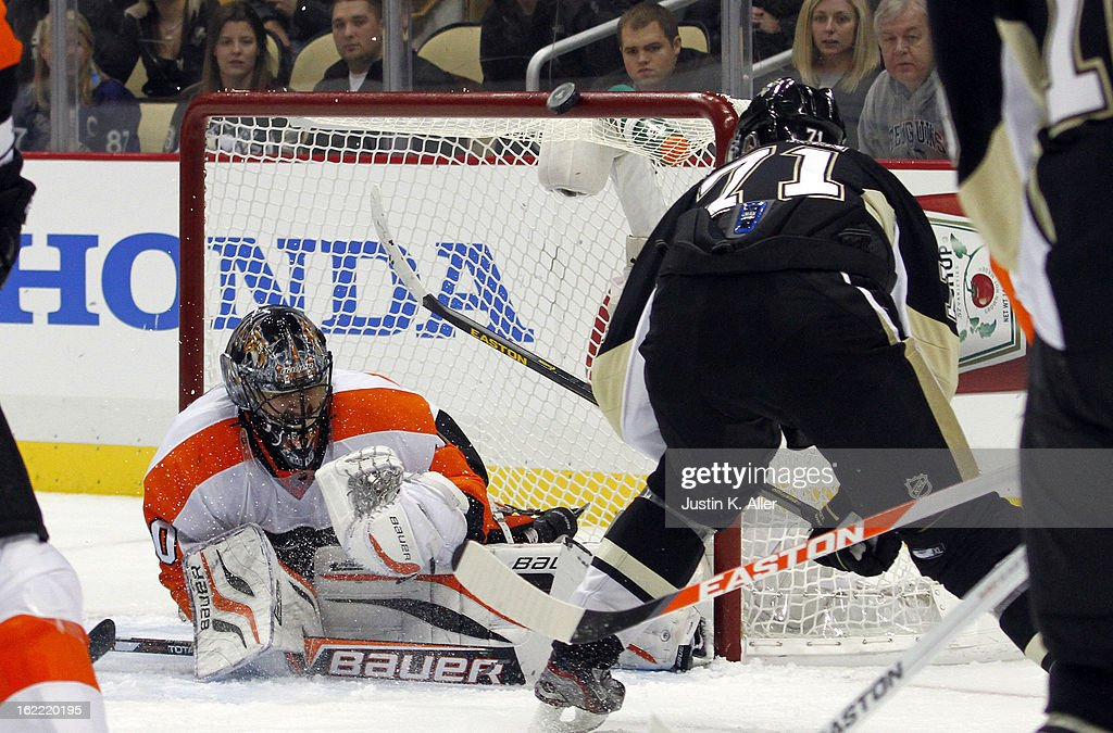 Evgeni Malkin #71 of the Pittsburgh Penguins hits the cross bar with a second remaining against Ilya Bryzgalov #30 of the Philadelphia Flyers during the game at Consol Energy Center on February 20, 2013 in Pittsburgh, Pennsylvania. The Flyers defeated the Penguins 6-5.